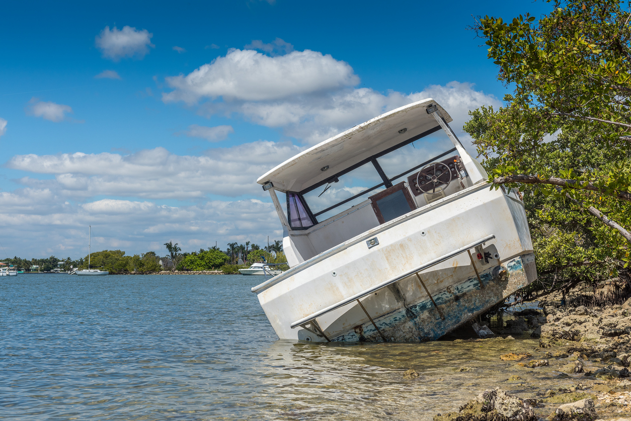 boat damaged and abandoned by the river