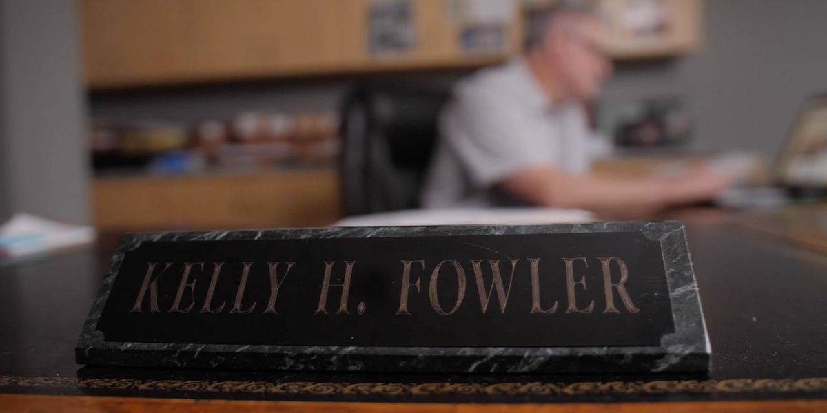 The name tag on Kelly Fowler's desk in his law firm office